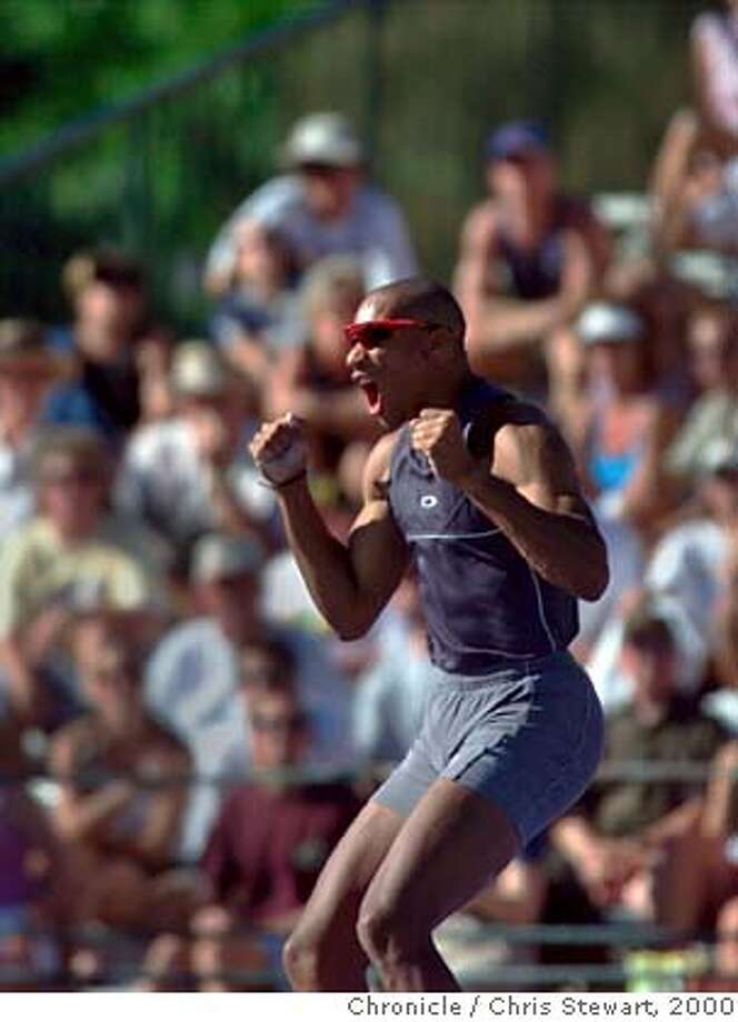 TRACK-HUFFINSYELL-21JUL00-SP-CS Decathlon leader Chris Huffins shouts at missing on his final jump at 4.70 meters in the men's decathlon pole vault at the 2000 U.S. Olympic track and field trials at Cal State Sacramento. Huffins finished in seventh place and holds a slim lead over Tom Pappas, who placed second in the pole vault. Only two events remain. BY CHRIS STEWART/THE CHRONICLE Photo: CHRIS STEWART