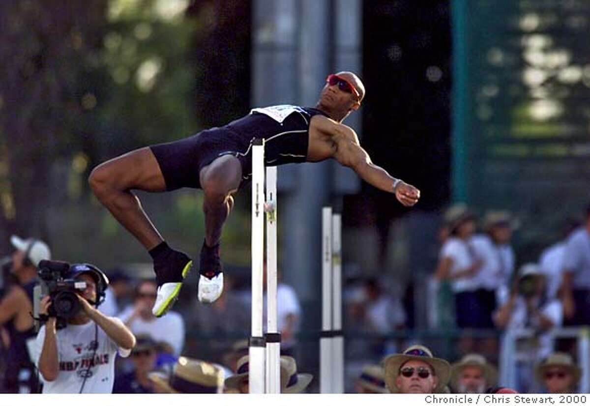 TRACK-HUFFINS-20JUL00-SP-CS Decathlon leader Chris Huffins competes in the men's decathlon high jump in Sacramento during the 2000 U.S. Olympic track and field trials at Cal State Sacramento. Huffins finished second in the event, but maintains a 100 point lead over Tom Pappas. BY CHRIS STEWART/THE CHRONICLE CAT