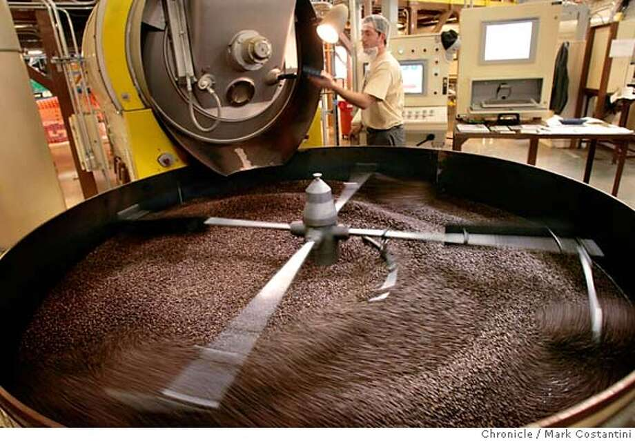 Roaster Eliseo Munoz tends to a freshly roasted batch.  New Peet's roasting plant in Alameda. Story will be on the magic of Peets roasting secrets and the coup for Alameda, which stole the venerable coffee maker from Emeryville and recently lured Clif Bar from Berkeley.  PHOTO: Mark Costantini / The Chronicle MANDATORY CREDIT FOR PHOTOGRAPHER AND SAN FRANCISCO CHRONICLE/NO SALES-MAGS OUT Photo: MARK COSTANTINI
