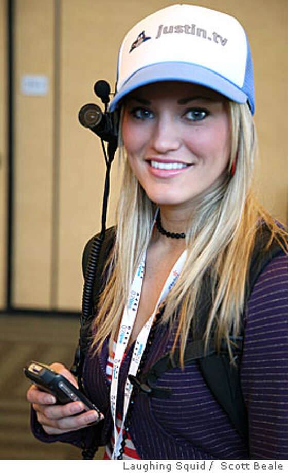 Justin.tv is launching its second channel. Meet Justine.tv. She�s a photogenic 23-year-old graphic designer and popular blogger and vlogger from Pittsburg, Penn., who is going to wear a camera 24/7 except in private places and at private moments. Credit: Scott Beale / Laughing Squid Photo: See Caption