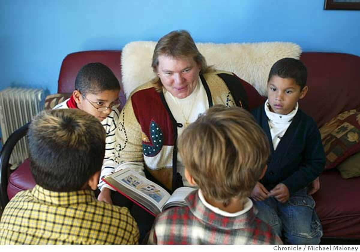 SOS_HADDAWAY_010_MJM.jpg Dawn Haddaway (center) reads a Christmas story to her adoptive boys Sam Haddaway 11, (left) and Jordan Haddaway 6, (right) and 9 year old