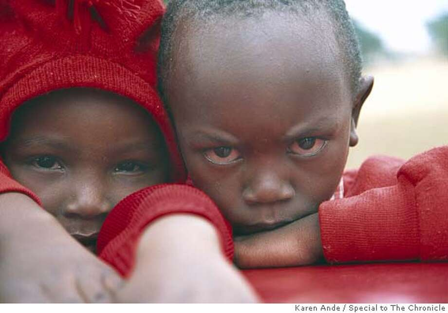 Sampson (right) is one of the AIDS orphans attending school at Mama Darlene's Children Center. Photo by Karen Ande/Special to The Chronicle Ran on: 12-04-2005  Sampson (right) attends school at Mama Darlene's Children Center, which offers a free education to 150 children whose parents died from AIDS. Photo: Karen Ande/Special To The Chroni