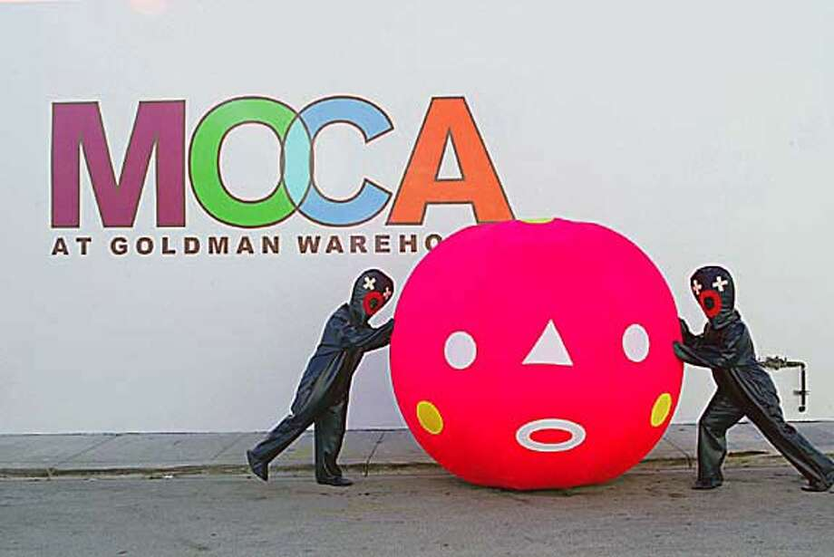 �2005 Alex Quesada / Polaris Miami, FL. 11/15/05 The artists Arturo Sandoval III and Sam Borkson practice some moves for their upcoming installation at the MOCA Annex at the Goldman Warehouse. Photo: Xxx