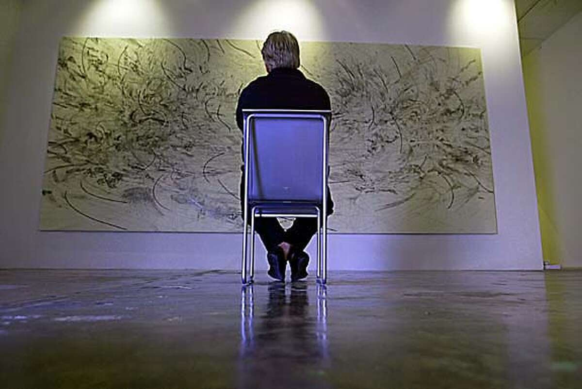 �2005 Alex Quesada / Polaris Miami, FL. 11/15/05 Dennis Scholl at his gallery; contemplating a painting.