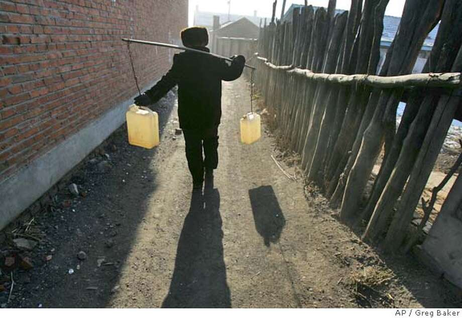 WATER DISTRIBUTION Photo: GREG BAKER