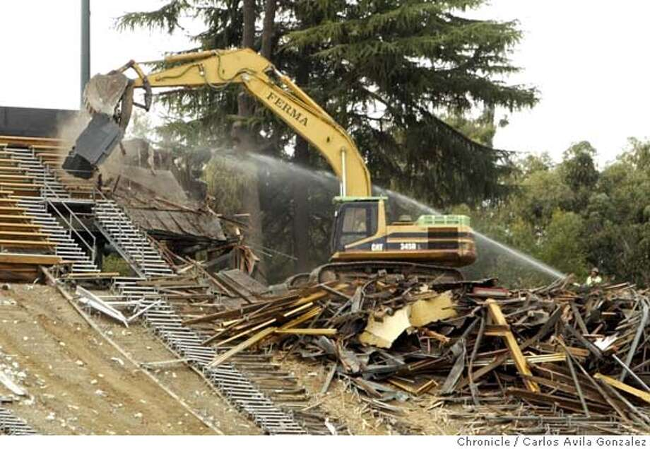 STADIUM_084_CAG.JPG  A hydrolic excavator demolishes portions of the upper seats at Stanford Stadium in Palo Alto, Ca., on Monday November 28, 2005. Monday is the first day of demolishing Stanford Stadium, built 84 years ago. Just looking for some good demolition shots. Anything nostalgic would be an added bonus. They're going to be rebuilding it quickly, hoping it's done for the 2006 football season.  Photo by Carlos Avila Gonzalez / The San Francisco Chronicle  Photo taken on 11/28/05 in Palo Alto, CA. MANDATORY CREDIT FOR PHOTOG AND SAN FRANCISCO CHRONICLE/ -MAGS OUT Photo: Carlos Avila Gonzalez