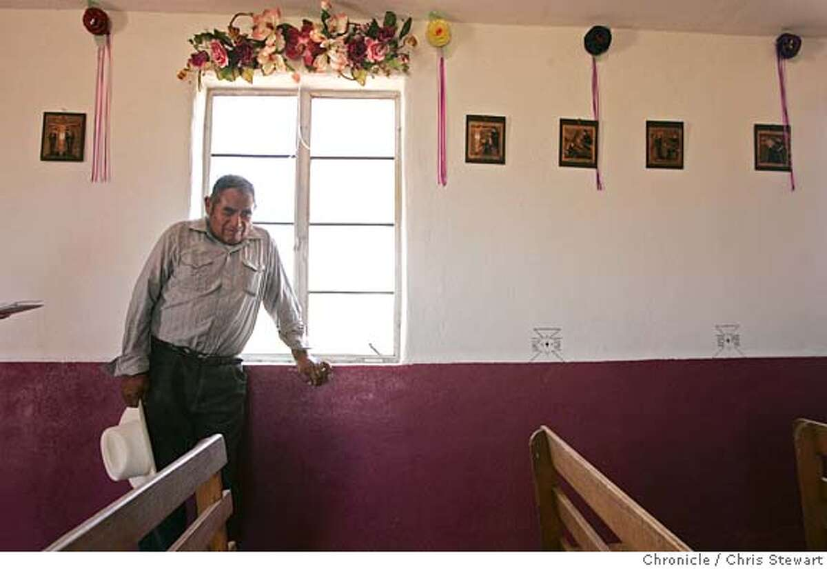 Harry Noriega of the Tohono O'odham Indian Nation, lives in Mexico, where he pauses for a moment in a small chapel, but regularly crosses the border onto the reservation. The Tohono O'odham, whose reservation straddles the border and struggles with migrant-related crime, trash and medical emergencies. We travel to the Arizona/Mexico border June 20-24 for a series of stories about what the border looks and feels like, how it affects the people and cultures nearby, and how it works from day to day. Chris Stewart / The Chronicle