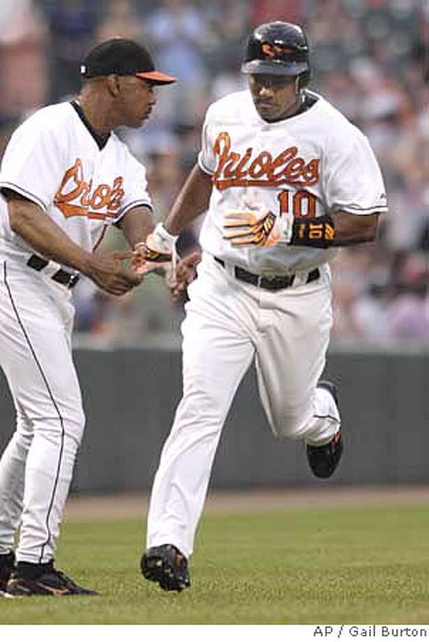 Miguel Tejada got the Orioles rolling with his first-inning home run. Associated Press photo by Gail Burton