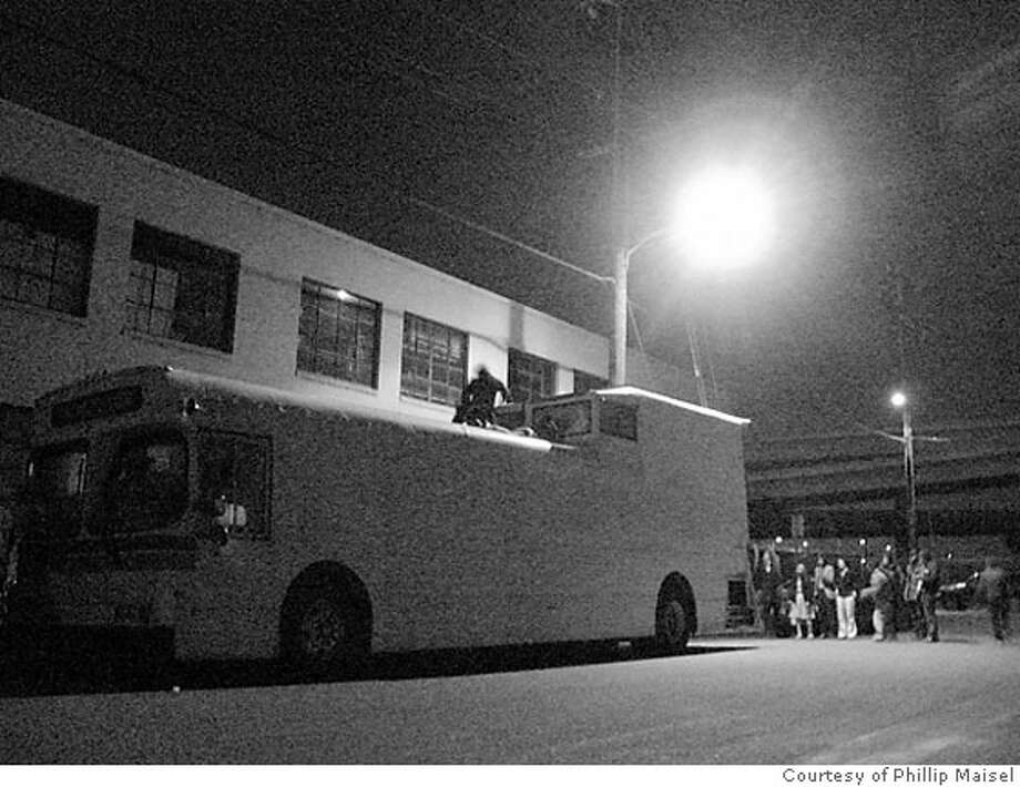 no photo id  Ran on: 05-27-2007  (Top left) Gig goers disguised as bus passengers line up in Oakland where Countless Others singer Tim Tinderholt (center) recently brought new meaning to putting the show on the road. Photo: HO