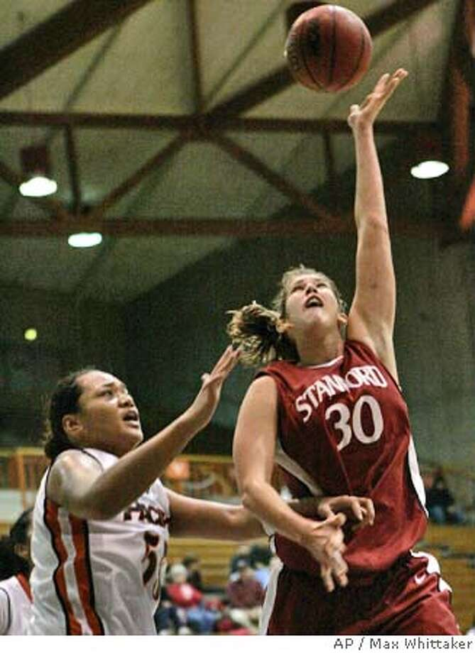 Stanford's Brooke Smith goes to the basket past Pacific's Tina Sanerivi during the second half in Stockton, Calif., on Thursday, Dec. 1, 2005. (AP Photo/Max Whittaker) Photo: MAX WHITTAKER