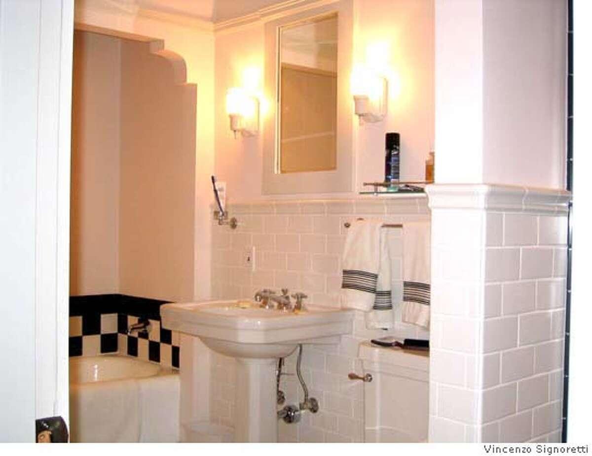 � The bathroom, restored to its original glory. Credit: Vincenzo Signoretti