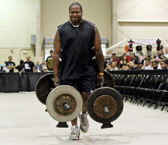 U.S. Army veteran and wounded warrior Zechary Gray, 37,  carries 120 pounds in each hand during the Shamrock Strength Showdown part of the San Antonio AutoRama & South Texas Motorcycle Show Sunday March 18, 2012 at the Freeman Coliseum. Photo: EDWARD A. ORNELAS, SAN ANTONIO EXPRESS-NEWS / © SAN ANTONIO EXPRESS-NEWS (NFS)