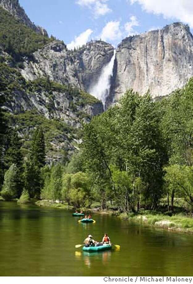 Visitors to Yosemite rent rafts for a lazy float down the Merced River which flows through the valley floor. In the background is upper Yosemite Falls.  Spring in Yosemite is a beautiful time to visit . Despite the lack of a good winter snowbase, the famous waterfalls of Yosemite are in full force bringing visitors from all over the world. Photo by Michael Maloney / San Francisco Chronicle MANDATORY CREDIT FOR PHOTOG AND SF CHRONICLE/NO SALES-MAGS OUT Photo: Michael Maloney