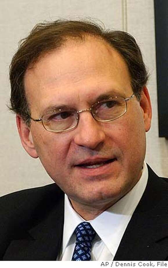 ** FILE ** In a file photo Judge Samuel Alito is seen Tuesday, Nov. 15, 2005 in Washington. Judge Samuel Alito has said he did not break a federal ethics law when he ruled in a case involving the company that handles his mutual fund investments. (AP Photo/Dennis Cook) NOV. 15, 2005, PHOTO Photo: DENNIS COOK