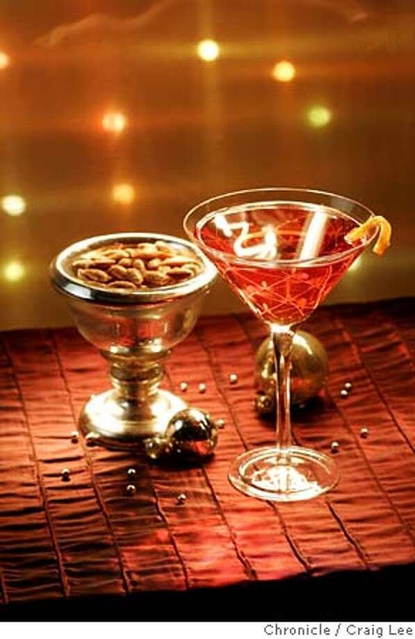 ENTERTAIN01_021_cl.JPG  Photo to illustrate aperitifs and nibbles. Photo of a campari drink in a martini glass next to a bowl of nuts. Styling by Ellie Winter, Hulda Nelson.  Event on 11/15/05 in San Francisco. Craig Lee / The Chronicle MANDATORY CREDIT FOR PHOTOG AND SF CHRONICLE/ -MAGS OUT Photo: Craig Lee
