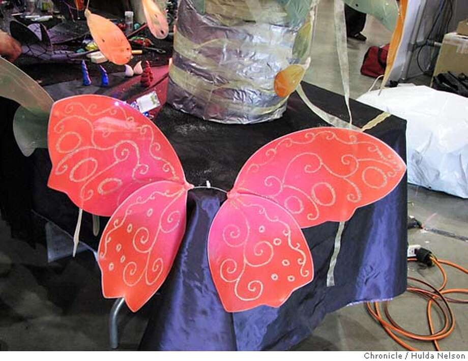 Fairy wings by Marie Danzer at the Maker Faire, 5/19/07. Made by hand from wire, elastic, spray paint, glitter, glue, LEDs mirrors, springs and other inventive materials. Photo: Hulda Nelson