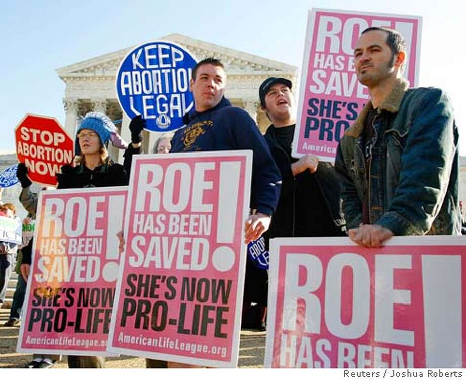 Anti-abortion protesters rally as the U.S. Supreme Court hears its first abortion case in five years in Washington November 30, 2005. The court will hear arguments on one of its most contentious issues when it considers a state law requiring notification of a parent before a minor can end her pregnancy. REUTERS/Joshua Roberts 0 Photo: JOSHUA ROBERTS
