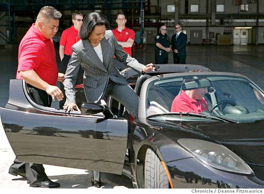 U.S. Secretary of State Condoleezza Rice (cq) meets with Tesla Motors officials and rides in a Tesla Roadster prototype. This vehicle, driven by Tom O'Leary (cq), sales manager with Tesla, is 0 emissions, 100% electric, lithium battery, goes from 0-60 mph in 4 seconds and gets 135 mpg. Deanne Fitzmaurice / The Chronicle Photo: Deanne Fitzmaurice