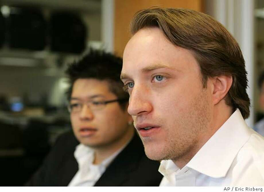YouTube co-founders Steve Chen, left, and Chad Hurley, right, during an interview at the Assoicated Press' bureau in San Francisco, Thursday, May 17, 2007. While major television and movie studios have been scrambling to assemble their own online video channels, Internet pioneer YouTube Inc. has been examining ways to move its content into the living room, co-founders Chad Hurley and Steve Chen said in an interview with The Associated Press. Hurley and Chen also discussed YouTube's plans to make money from video ads and introduce technology to protect copyright holders. (AP Photo/Eric Risberg) Photo: Eric Risberg