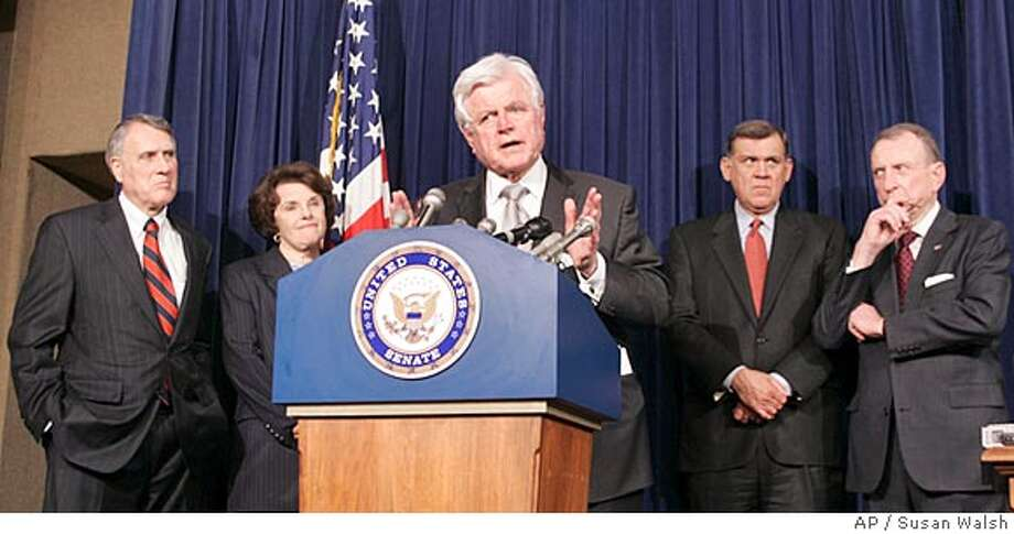 Sen. Edward Kennedy, D-Mass., at podium, accompanied by fellow Senators, gestures during a news conference on immigration legislation, Thursday, May 24, 2007, on Capitol Hill in Washington. From left are, Sen. Jon Kyl, R-Ariz., Sen. Dianne Feinstein, D-Calif., Kennedy, Sen. Mel Martinez, R-Fla., And Sen. Arlen Specter, R-Pa., listen. (AP Photo/Susan Walsh) Photo: Susan Walsh