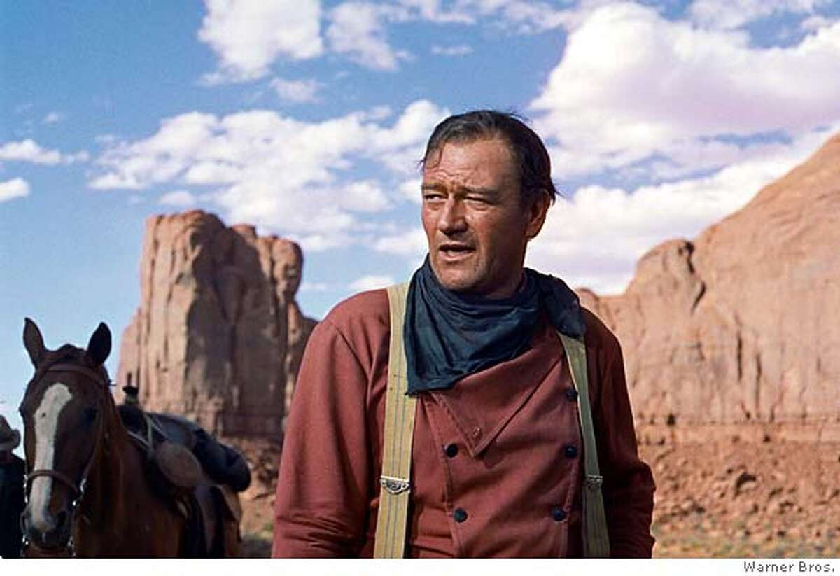"""**FILE**In this photo released by Warner Bros., actor John Wayne plays Ethan Edwards in the 1956 film """"The Searchers."""" Director John Ford and frequent leading man Wayne forged one of Hollywood's most enduring partnerships. Wayne, born Marion Robert Morrison, would have turned 100 on Saturday, May 26, 2007. He died at the age of 72 of stomach cancer in June of 1979 after a career that spanned more than 170 films (AP Photo/Warner Bros.) NO SALES, PHOTO PROVIDED BY WARNER BROS."""