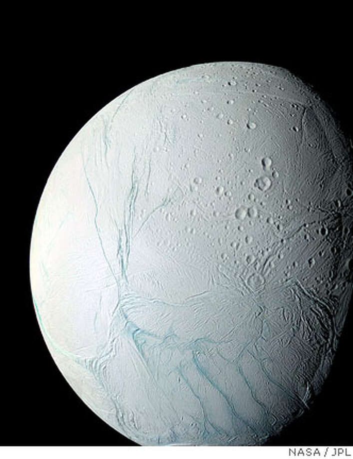 (NYT33) UNDATED -- March 9, 2006 -- SATURN-MOON-WATER -- This March 9, 2006 NASA Cassini space probe mosaic image shows Saturn's moon Enceladus. The Cassini space probe may have found water on Saturn's Enceladus moon, NASA said Thursday. (NASA/JPL via The New York Times) *EDITORIAL USE ONLY - MAGS OUT/NO SALES - FOR USE ONLY WITH STORY SLUGGED: SATURN-MOON-WATER by Kenneth Chang. -- ALL OTHER USE PROHIBITEDRan on: 03-10-2006  Images from the Cassini spacecraft show Enceladus. The color-coded version reveals an extended plume component, with icy material extending above the moon's southern polar region.  Ran on: 05-25-2007  Four parallel cracks in Enceladus' crust, known as the &quo;tiger stripes,&quo; lie in the moon's seismically active south polar region.  Ran on: 05-25-2007  Enceladus, a small, icy moon of Saturn, is seen in a mosaic image taken by Nasa's Cassini space probe in March 2006. Photo: NYT