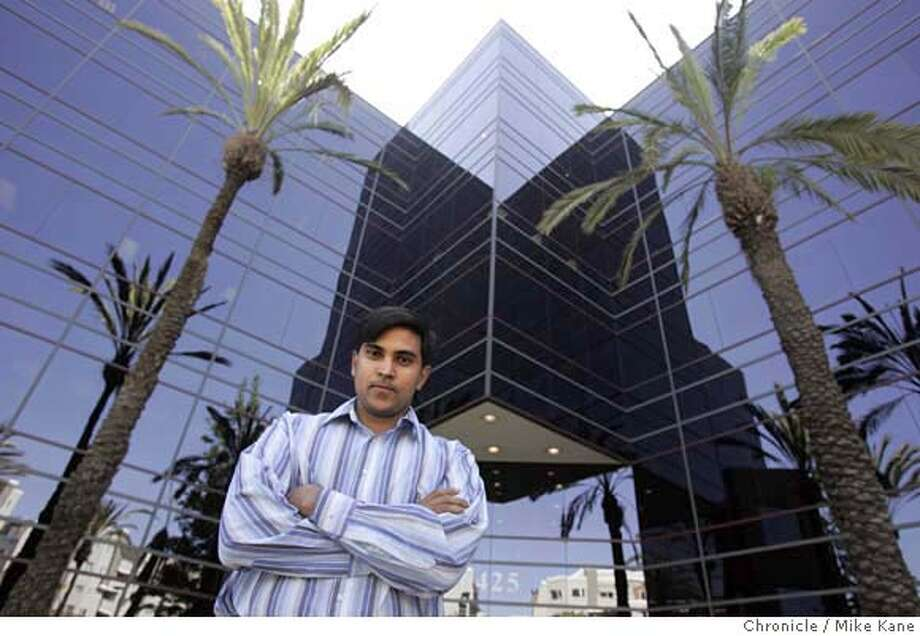 Indian software engineer Mahesh Pasupuleti stands in front of the office building in which he works in Emeryville, CA, on Wednesday, May, 23, 2007. Pasupuleti has invested 8 years working legally in the U.S on an HB1 Visa and worries that Senate-proposed immigration reform may disrupt his pursuit for a green card. photo taken: 5/23/07  Mike Kane / The Chronicle **Mahesh Pasupuleti Photo: MIKE KANE