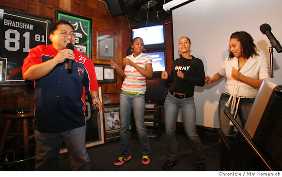 "SOUNDSCENE_RICKYS_142_KK.JPG  Ponch Lunzaga of Oakland sings ""My Girl"" as a group of backup danceers materializes from the audience at Karaoke night at Ricky's Sports Theater and Grill in San Leandro.  Photo by Kim Komenich/The Chronicle  **Ponch Lunzaga Photo: Kim Komenich"