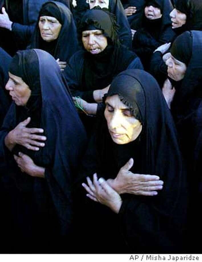 9/1/2003 | Color | 3star | 10p10 x full | a1 | A-Section | steve, 6026 | IRAQ #2 Photo: MISHA JAPARIDZE