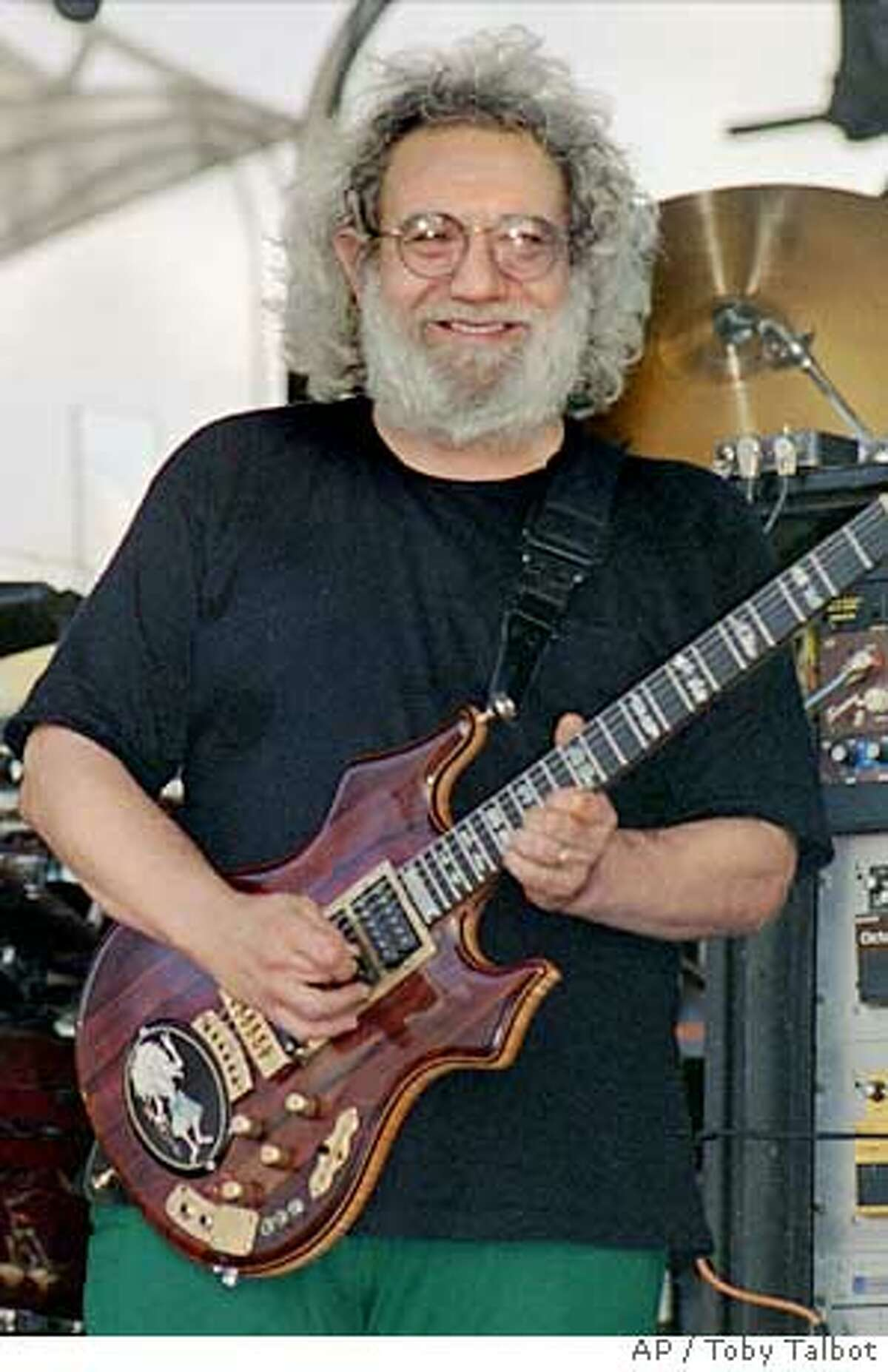 ** FILE ** Jerry Garcia of the Grateful Dead smiles as he plays in Highgate, Vt., in this July 1994 file photo. A nonprofit group hopes to raise more than $100,000 when it auctions a subzero degree freezer, stereo cabinets and other home appliances that once belonged to Jerry Garcia, lead guitarist of the rock band The Grateful Dead. The items, which also include toilets, cupboards and a dishwasher, will be available for bidding on the online auction site eBay from Dec. 18 through Dec. 24, 2005. (AP Photo/Toby Talbot) Ran on: 11-30-2005 Jerry Garcia, late lead guitarist of the Grateful Dead, lived in a mansion in Nicasio in the early 1990s. Three toilets from that home are among Garcias household items to be auction- ed on eBay. Ran on: 11-30-2005 Jerry Garcia, late lead guitarist of the Grateful Dead, lived in a mansion in Nicasio in the early 1990s. Three toilets from that home are among Garcias household items to be auction- ed on eBay.