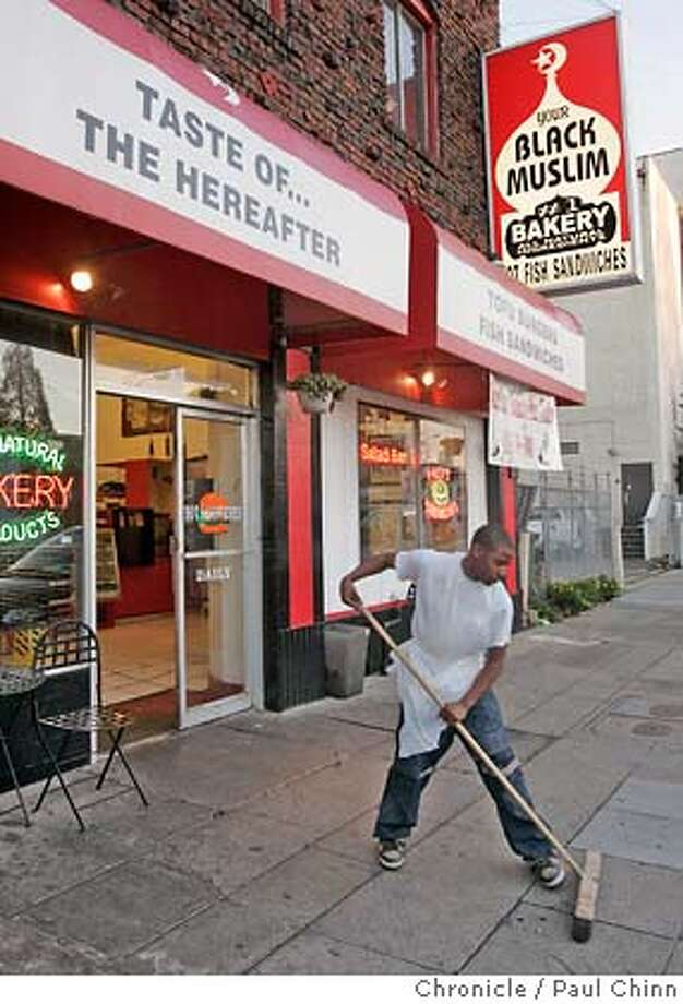 A unidentified employee (who would not give his name out to the media) sweeps the sidewalk in front of the Your Black Muslim Bakery shop after police officials announce the arrest of two men, including Yusef Bey IV, in connection with the vandalism of a liquor store in Oakland, Calif. on 11/29/05.  PAUL CHINN/The Chronicle Photo: PAUL CHINN