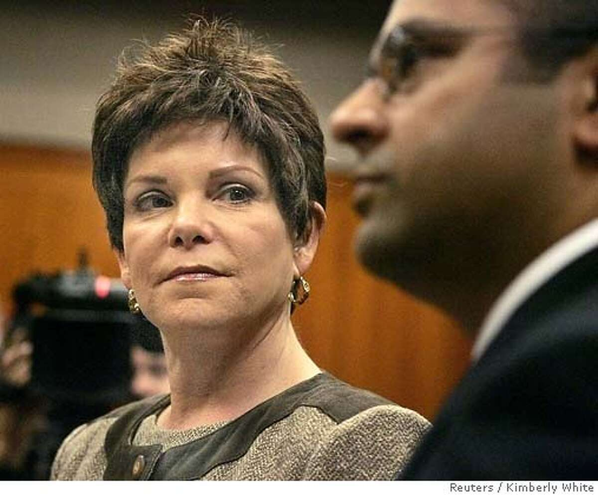 Former Hewlett-Packard Co. Chairman Patricia Dunn (L) looks at her attorney Raj Chatterjee inside a courtroom during her arraignment in San Jose, California, November 15, 2006. Dunn pleaded not guilty to felony charges for spying on reporters and directors in a scandal that sullied the reputation one of Silicon Valley's most venerable and respected companies. REUTERS/Kimberly White (UNITED STATES) Ran on: 11-16-2006 Patricia Dunn looks at her attorney, Raj Chatterjee, during her arraignment. Ran on: 03-15-2007 Stanford Associate Professor Vijay Pande