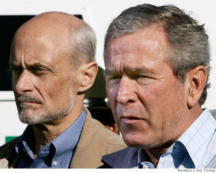 "U.S. President George W. Bush and Homeland Security Secretary Michael Chertoff (L) speak near the Mexican border in El Paso, Texas, November 29, 2005. Bush on Monday tried to balance differences in his own Republican Party over illegal immigration by rejecting amnesty and calling for a hardened Mexico border but also vowing the U.S. would remain ""a welcoming society."" REUTERS/Jim Young 0 Photo: JIM YOUNG"