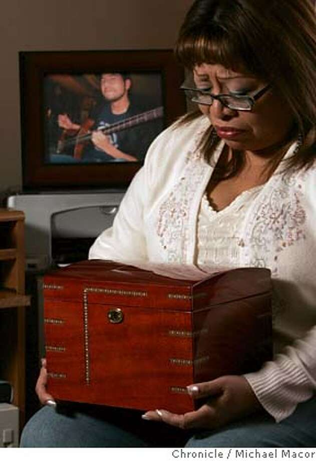 autopsy06_020_mac.jpg Selina Picon, holds the wooden urn that contains her son's heart, returned by the coroner. Selina has never opened the box, she keeps the box under her bed. Their son's death, from a rare heart defect, was the first shock for Joe and Selina Picon. the second was her discovery that the San Mateo County coroner had kept the heart of their 23 year old son, Nick, without notifying her, which is allowed by state law. After raising a big fuss, the coroner returned the heart to her and now the County Supervisors are working to change the law on the statewide level. Photographed in, San Francisco, Ca, on 2/2/07. Photo by: Michael Macor/ San Francisco Chronicle Ran on: 02-06-2007  Selina Picon holds the wooden box that contains her son's heart, which was returned to her.  Ran on: 02-06-2007  Selina Picon holds the wooden box that contains her son's heart, which was returned to her. Mandatory credit for Photographer and San Francisco Chronicle No sales/ Magazines Out Photo: Michael Macor