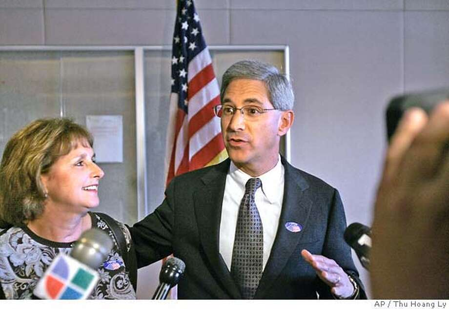 Steve Poizner, candidate for California State Insurance Commissioner, is flanked by his wife, Carol, as he talks to reporters after casting his absentee ballot at the Santa Clara County Registrar of Voters, in San Jose, Calif., Tuesday, Nov., 7, 2006. (AP Photo/Mercury News, Thu Hoang Ly)  Ran on: 11-08-2006  Steve Poizner, the Republican candidate for state insurance commissioner, with his wife, Carol, beside him, talks to reporters after casting his absentee ballot in San Jose.  Ran on: 11-08-2006 Ran on: 11-08-2006  Steve Poizner, the Republican candidate for state insurance commissioner, with his wife, Carol, beside him, talks to reporters after casting his absentee ballot in San Jose.  Ran on: 11-08-2006 MAGS OUT NO SALES Photo: THU HOANG LY