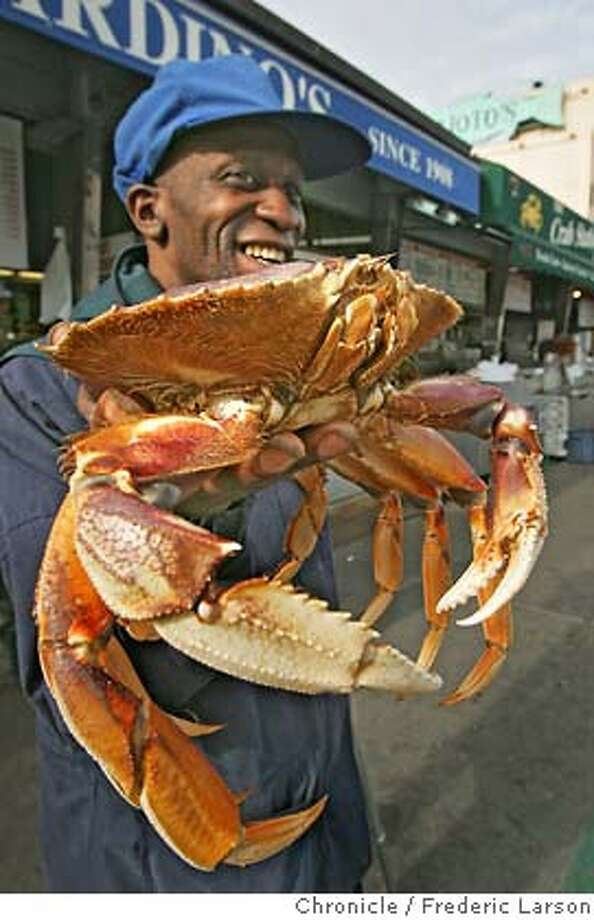 "CRAB_070_fl.jpg Reg Dillard a SF native of 48 years comes down to the wharf to get fresh crab. To the delight of seafood lovers, San Francisco's fishing fleet motored into Fisherman's Wharf this morning with holds full of Dungeness crab, nearly two weeks after the season opened and after local crabbers and processors settled a price dispute. This morning, the cooked crabs were stacked like cordwood at Fishermen's Wharf, and additional boats were expected to land throughout the afternoon. The average retail price was $6.75 a pound. ""They're nice size, and they're full of meat,"" said Michael Guardino, the owner of Guardino's #1 on Fishermen's Wharf. ""Our customers wait all year for this local crab.""  The season got off to a rocky start on November 15, when fishermen and processors couldn't agree on a price. The fishermen wanted $1.85 a pound. The processors offered from $1.15 to $1.50 a pound. The fishermen said they couldn't make a profit at the offered prices, so they stayed in port. The impasse was broken Saturday, when the two groups agreed on a price of $1.75 a pound and more than 100 commercial boats went to sea from San Francisco, Half Moon Bay and Bodega Bay. 11/29/05 San Francisco CA Frederic Larson San Francisco Chronicle Photo: Frederic Larson"