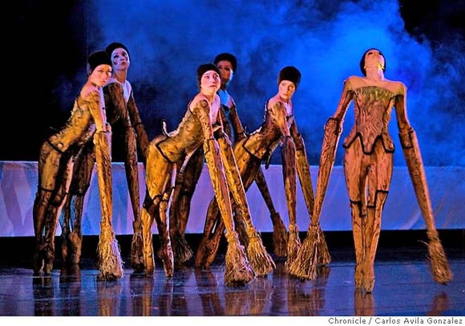 "OAKLANDBALLET_007_CAG.JPG  The Sorcerer's Apprentice, based on the poem ""Der Zauberlehrling,"" by Goethe. Apprentice played by Gabriel Williams. The Broom played by Jennifer Tierney. The Sorcerer played by Paunika Jones, Joseph Copley and Matthew Linzer. Ensemble - Genevieve Custer, Phaedra Jarrett, Yuka Momori, Cynthia Sheppard and mariko Takahashi. Dress rehearsal of The Oakland Ballet's Repertory Program 2, at the Calvin Simmons Theater in Oakland, Ca., on Wednesday, November 23, 2005. Photo by Carlos Avila Gonzalez / The San Francisco Chronicle  Photo taken on 11/23/05 in Oakland, CA. MANDATORY CREDIT FOR PHOTOG AND SAN FRANCISCO CHRONICLE/ -MAGS OUT Photo: Carlos Avila Gonzalez"