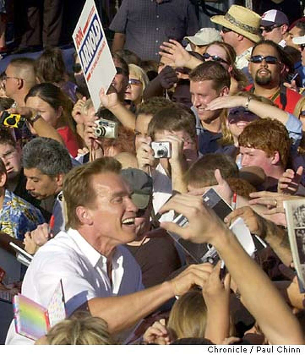 arnold220_pc.jpg Schwarzenegger went out into the crowd to shake hands with supporters after a rally at River Park shopping center. Schwarzenegger campaigns at three locations in Fresno on 8/28/03. PAUL CHINN / The Chronicle