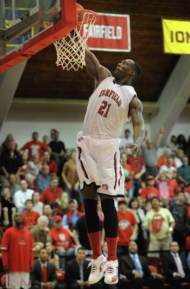 Fairfield's Rakim Sanders slams home a dunk during the Stags' victory over Manhattan in the second round of the CollegeInsider.com Postseason Tournament at Alumni Hall in Fairfield on Sunday, March 18, 2012. Photo: Brian A. Pounds / Connecticut Post