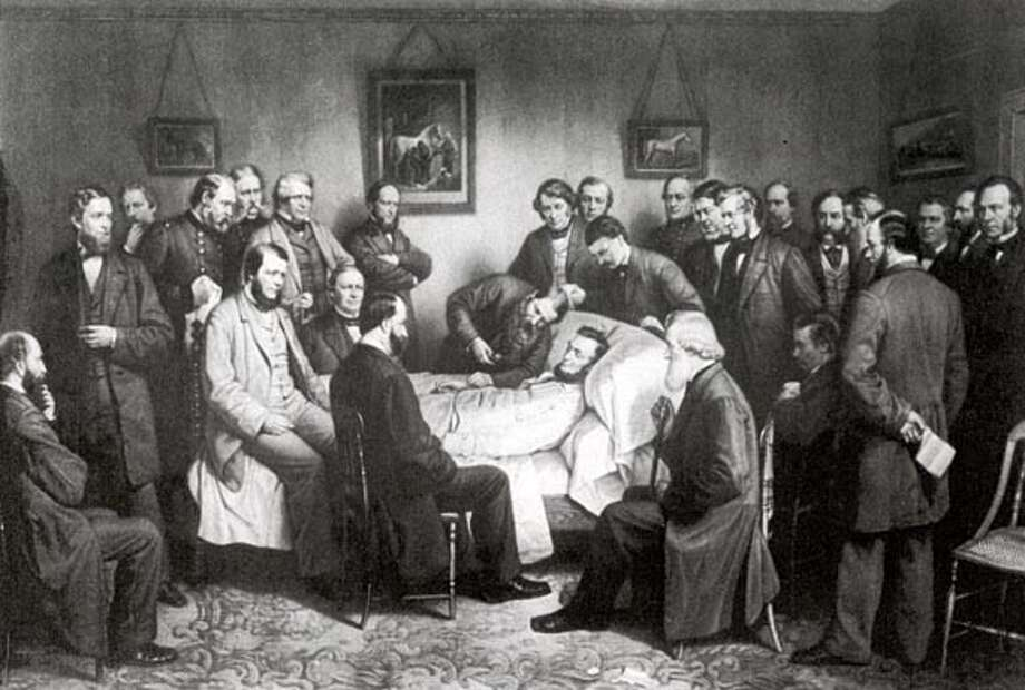 As Lincoln lay dying he is surrounded by family, military officials, senators, congressmen and members of his cabinet.