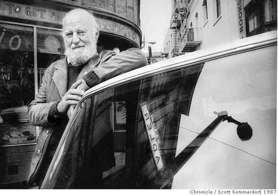 Photographed in August of 1987, Lawrence Ferlinghetti, owner of City Lights Bookstore led a fight to change the name of ADLER PLACE to JACK KEROUAC ALLEY. City Lights Bookstore is now at the corner of Columbus and Jack Kerouac Alley in San Francisco's North Beach. Here he poses next to his pickup truck with the old streetsign relfected in the windshield . SF CHRONICLE PHOTO BY SCOTT SOMMERDORF - 1987