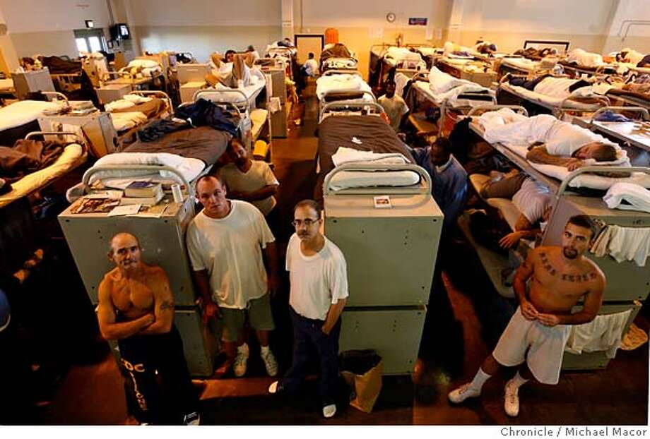 overcrowdedprisons_077_mac.jpg Prisoners l to r- Ronald Rule,51, Jason Seidel,26, Cecil Goodrum,44 and Jarrett Smith, 24. Wesley Wallace,42 in in the back behind Seidel. Prisoners inside the D-Building gymnasium where inmates are housed due to overcrowding. Bunks are stacked three high to accomodate the imates. Pleasant Valley Sate Prison in Coalinga, Ca., one the most overcrowed prisons in the State of California. the prison population reaching close to 225% of the capacity it was designed for some 10 years ago. Event in, Coalinga, Ca, on 12/5/06. Photo by: Michael Macor/ San Francisco Chronicle Mandatory credit for Photographer and San Francisco Chronicle No sales/ Magazines Out Photo: Michael Macor