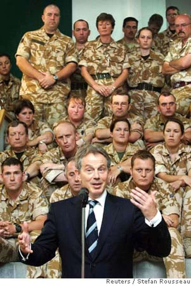 Britain's Prime Minister Tony Blair speaks to British soldiers at Divisional Headquarters in Basra May 19, 2007. Blair, on his last visit to Iraq as prime minister, said on Saturday he had no regrets about his part in the U.S.-led invasion that removed Saddam Hussein. On a farewell trip to a country whose future may define his legacy after a decade in power, Blair met Iraqi Prime Minister Nuri al-Maliki and President Jalal Talabani and discussed the situation in Iraq, which is beset by sectarian violence. REUTERS/Stefan Rousseau/WPA/Pool (IRAQ)  Ran on: 05-20-2007  British Prime Minister Tony Blair speaks to British soldiers in Basra. Blair says he saw &quo;real signs of {hellip} progress&quo; in Iraq. Photo: POOL