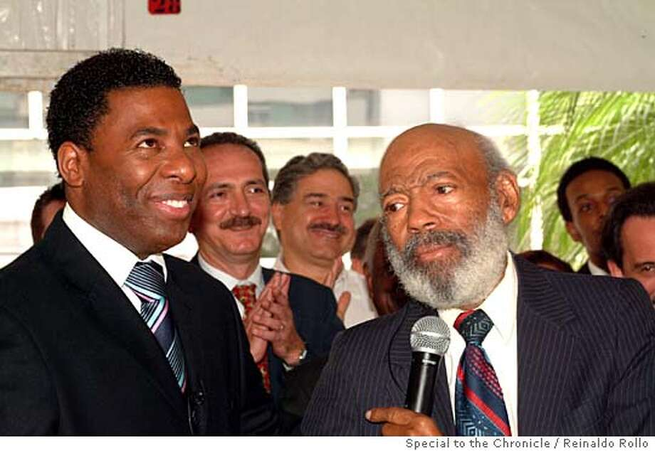 "Jose de Paula Neto and James Meredith together at the launch of ""Our TV."" Photo by Reinaldo Rollo/Special to The Chronicle Ran on: 11-27-2005  Jose de Paula Neto (left) of TV da Gente is joined by U.S. civil rights pioneer James Meredith. Photo: Reinaldo Rollo/Special To The Ch"