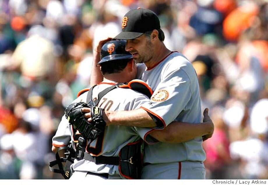 San Francisco Giants pitcher Matt Morris is congratulated by catcher Eliezer Alfonzo at the end of the game after defeating the Oakland , 4-1 in the last game of the series, Sunday May 20, in Oakland, Ca. .(Lacy Atkins /San Francisco Chronicle) Photo: Lacy Atkins