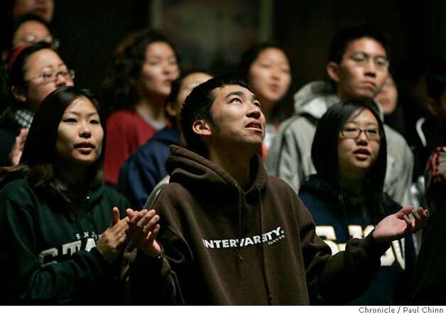 Susan Cheong, Matt Lee and Susan Yoon (L to R) worship during a morning session at the Origin of Our Dreams conference for Asian Christians at the the Mt. Gilead Bible Camp and Conference Center in Sebastopol, Calif. on Saturday, April 14, 2007. About 100 Asian American university students attended the weekend retreat to discuss how their faith affects their race, ethnicity and culture.  PAUL CHINN/The Chronicle  **Susan Cheong, Matt Lee, Susan Yoon MANDATORY CREDIT FOR PHOTOGRAPHER AND S.F. CHRONICLE/NO SALES - MAGS OUT Photo: PAUL CHINN