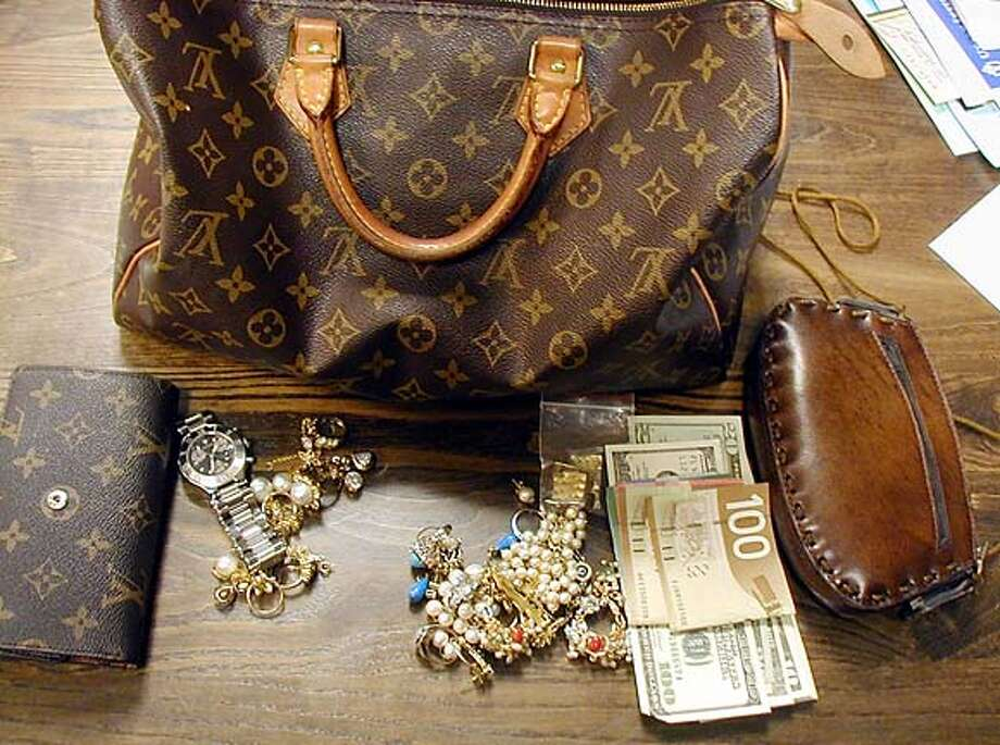 In this photo provided by the Sausalito Police Department, a Louis Vuitton bag containing jewelry and cash is shown Monday, March 27, 2006, in Sausalito, Calif. John Suhrhoff found the Louis Vuitton bag on a Sausalito park bench during a lunch stop in the scenic city following a weekend hike. Inside the bag, police say, was a treasure trove: a 12-carat diamond ring, pearl and emerald jewelry, a Cartier watch and roughly $500 in Canadian and American cash. The contents were worth a cool $1 million. (AP Photo/Courtesy Sausalito Police Department via The Marin Independent-Journal)Ran on: 03-29-2006  Inside Shahla Ghannadian's purse were a diamond ring, emerald jewelry, a Cartier watch and cash, all worth more than $1 million.Ran on: 03-29-2006  Ran on: 03-29-2006  Inside Shahla Ghannadian's purse were a diamond ring, emerald jewelry, a Cartier watch and cash, all worth more than $1 million.Ran on: 03-29-2006  Ran on: 03-29-2006  Inside Shahla Ghannadian's purse were a diamond ring, emerald jewelry, a Cartier watch and cash, all worth more than $1 million. COURTESY SAUSALITO POLICE DEPARTMENT VIA THE MARIN INDEPENDENT-JOURNA Photo: V