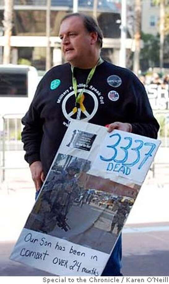 Tim Kahlor holds a sign with his son's picture on it outside the California Democratic Convention. Photo: Karen O'Neill / Special To The C