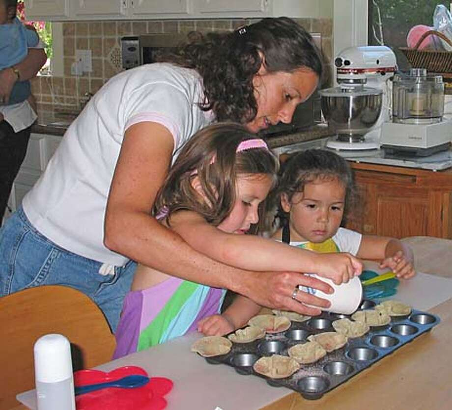 Michelle Stern, a former science teacher, teaches kids to cook in her What's Cookin' workshops. Credit: HO Photo: HO