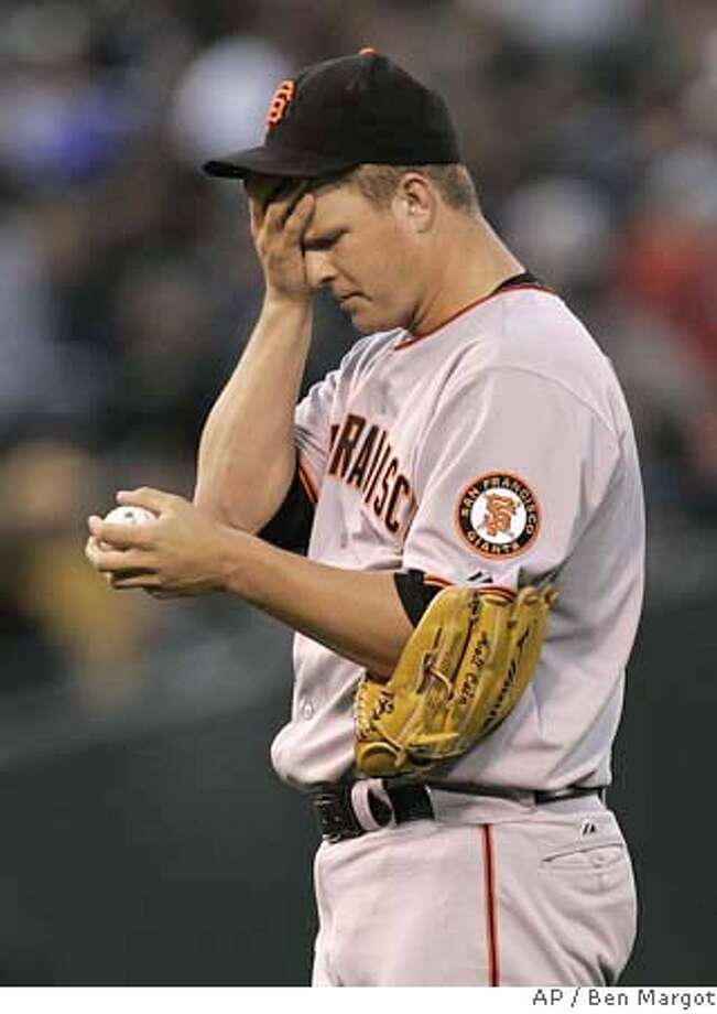 San Francisco Giants' Matt Cain wipes his brow in the seventh inning of a baseball game against the Oakland Athletics Saturday, May 19, 2007, in Oakland, Calif. The A's won, 4-2. (AP Photo/Ben Margot) Photo: Ben Margot